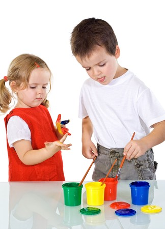 Kids having some fun with different color paints - isolated photo