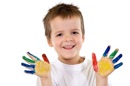 hand colored: Happy smiling boy with painted hands - isolated Stock Photo