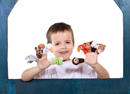 Smiling kid playing with finger puppets - isolated Stock Photo - 4209778