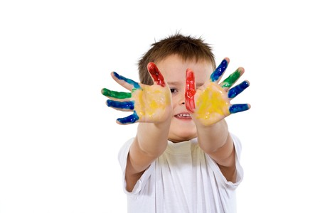 Smiling boy with hands painted in various colors - isolated Stock Photo - 4209775