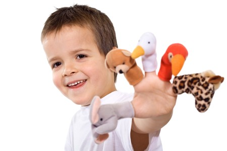Happy boy playing and showing his finger puppets - isolated Stock Photo - 4340524