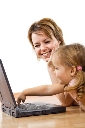 Little girl learning to use a computer - isolated, focus on th woman face Stock Photo - 4340548