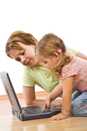 Little girl and woman with a laptop - closeup, isolated, focus on the girl face Stock Photo - 4340574