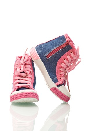 lacing sneakers: Pink sneakers for little girls - isolated with reflection Stock Photo