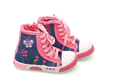 lacing sneakers: Little fairy sneakers for girls - isolated Stock Photo