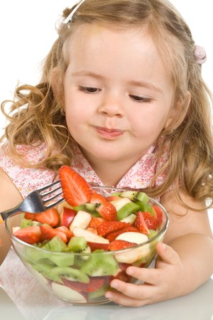 Little girl with fruit salad - closeup, isolated Stock Photo - 4399774