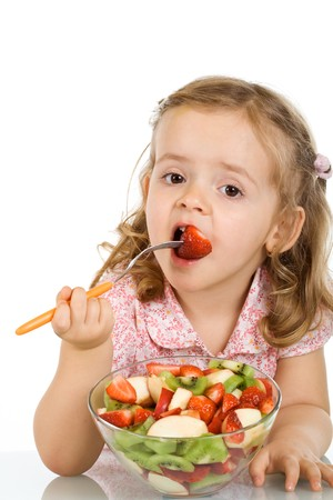 salad fork: Little girl eating fruit salad - healthy food concept - isolated