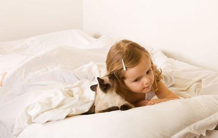 Best friends whispering - little girl with her kitten Stock Photo - 4761872