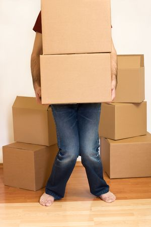 Man struggling lifting cardboard boxes - moving concept Stock Photo - 4761994