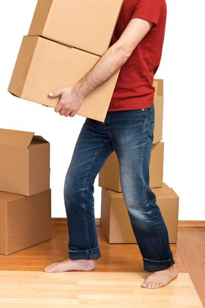 Man with lots of cardboard boxes - moving concept Stock Photo - 4762001