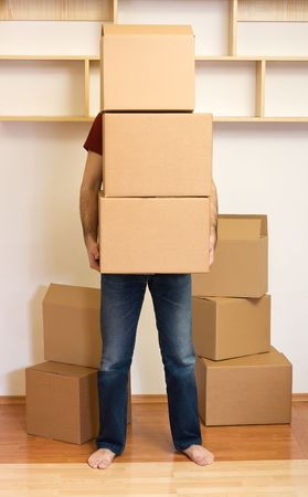 Man carrying lots of boxes - moving to a new home concept Stock Photo - 4831105