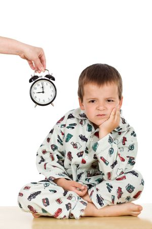 displeased: Bedtime for a displeased kid in pajamas - isolated