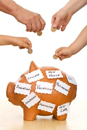 different goals: Hands of different generations putting coins into a piggy bank labeled with goals, isolated - home finances Stock Photo