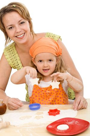 Happy woman and little girl making cookies together - isolated photo