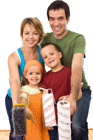 Happy family with brushes and painting rolls getting ready to repaint their home together - isolated Stock Photo - 5186189