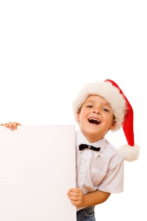 Happy laughing christmas hat boy with blank cardboard for your message - isolated Stock Photo - 5743708