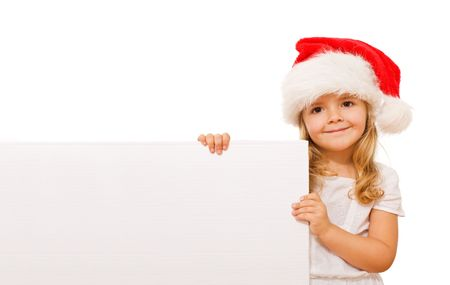 Happy little girl with santa hat and white cardboard - isolated christmas message Stock Photo - 5743707