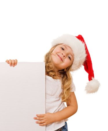 Smiling little girl with christmas hat holding white banner - isolated photo