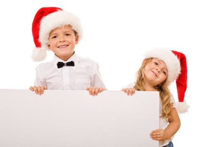 Kids with santa hats and white banner for text - christmas message, isolated photo