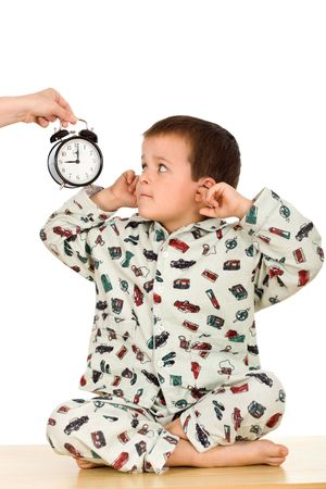 unruly: Kid does not want to hear about bedtime - isolated Stock Photo