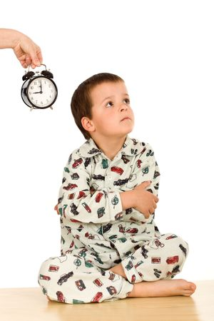 disobedient: Kid not happy about sleeping - bedtime concept, isolated