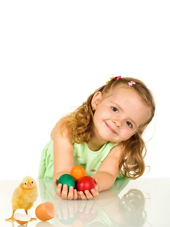 Adorable beautiful little girl smiling with colorful easter eggs - isolated photo