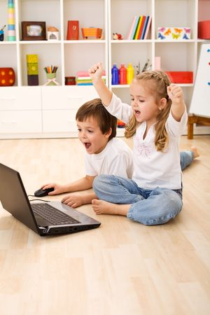 computer game: Stressed or excited kids about to win computer game Stock Photo