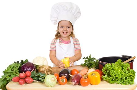 cute kid: Happy little chef with vegetables preparing a healthy meal