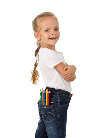 Little proud girl with pencils in her pocket ready for school - isolated photo