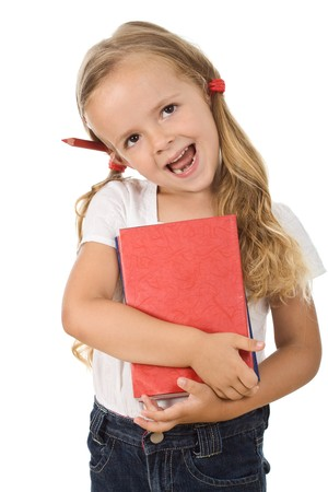 Happy little girl with books and pencil behind the ear - back to school concept, isolated photo