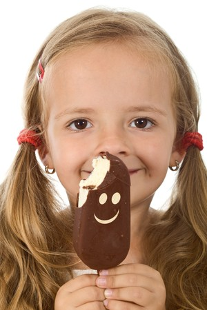 Little girl with plaits holding ice cream smiling happily - isolated, closeup photo