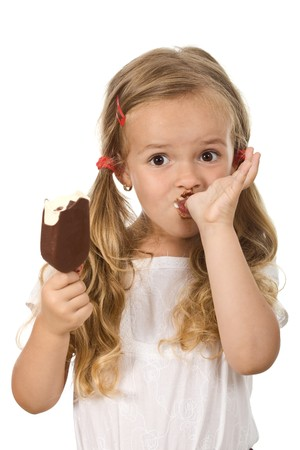 sucking: Little girl eating icecream licking fingers - isolated Stock Photo
