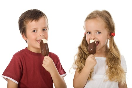 Kids eating icecream - isolated photo