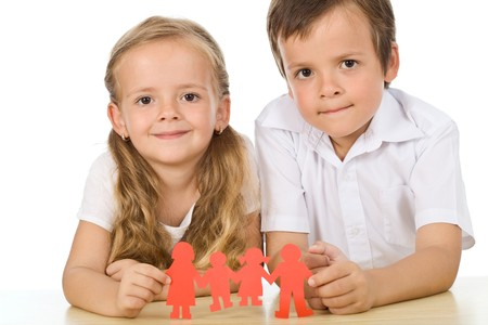 Kids holding paper people - happy family concept, isolated photo