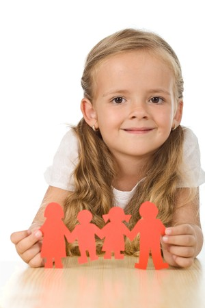 Little girl smiling and holding paper people - family concept Stock Photo - 7857365