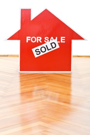 Selling houses concept with a sold sign on the floor indoors Stock Photo - 7857334