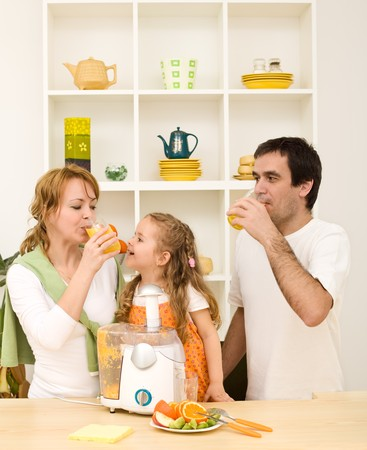 juicer: Family making and drinking fresh fruit juice - healthy diet concept