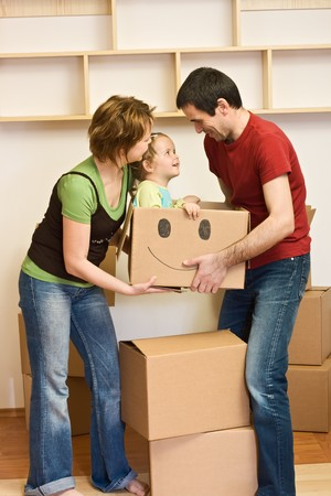 Happy family with a kid moving into a new home concept photo