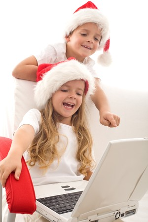 Writing a letter to santa is not what it used to be - computer generation kids emailing their christmas wishes Stock Photo - 8114416