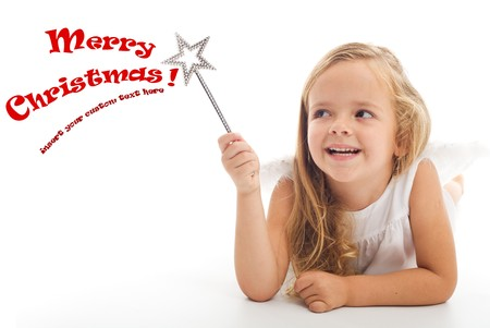 girl magic wand: Happy christmas wizard girl with magic wand - isolated with copy space Stock Photo