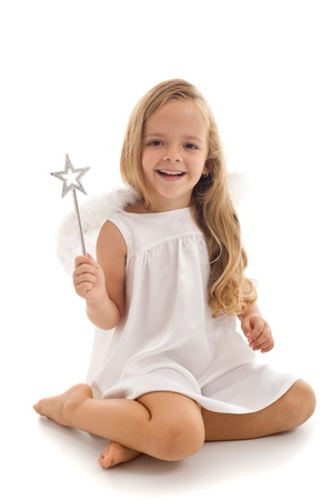 girl magic wand: Little happy fairy or angel with magic wand sitting - isolated Stock Photo