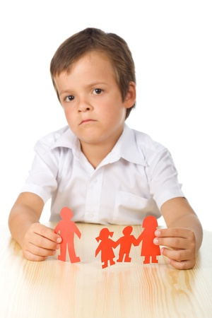 seperation: Divorce concept with sad kid holding separated paper people family - isolated