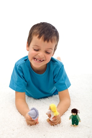 grimacing: Little boy playing domestic violence game with puppets grimacing and shouting Stock Photo