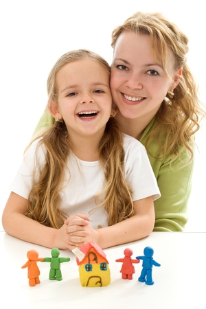happy family concept: Woman and laughing little girl with clay people and house - happy family concept, isolated