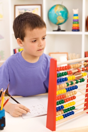 abacus: Kid doing math exercise counting with abacus