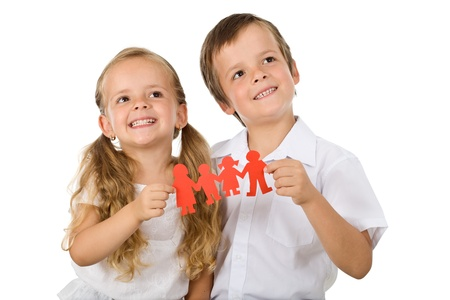 happy family concept: Kids holding paper people family and smiling - happy family concept
