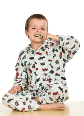 teeths: Kid washing teeths wearing pajamas