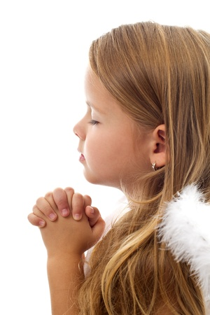 praying people: Adorable little girl praying peacefully - isolated, closeup Stock Photo