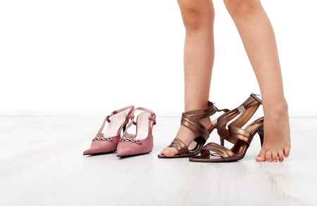 girl feet: Little girl feet trying large shoes with high heels