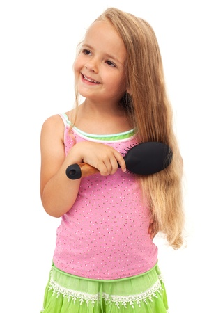 hairbrush: Little girl combing her long beautiful hair
